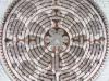 Roosvenster en labyrint; ze corresponderen met elkaar...